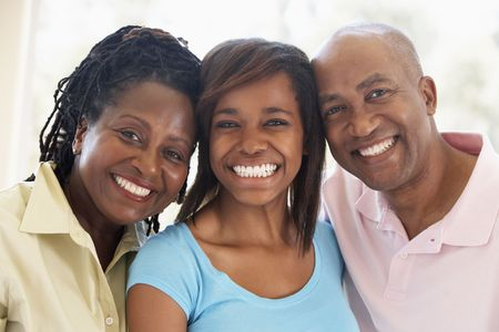 Couple With Their Teenage Daughter Stock Photo - 4646501