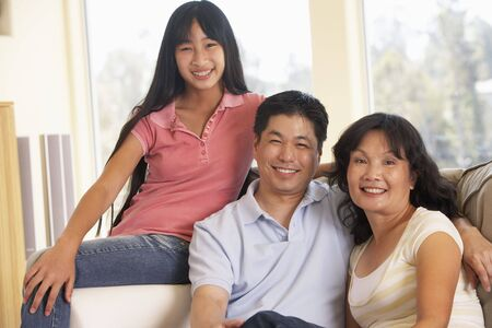 Family Sitting Together At Home Stock Photo - 4646482