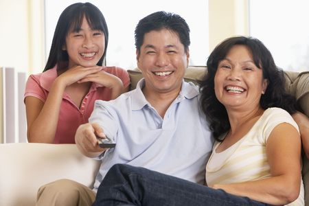 Family Watching Television Together photo
