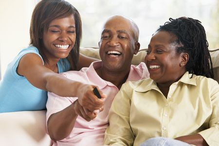 Family Watching Television Together Stock Photo - 4646462