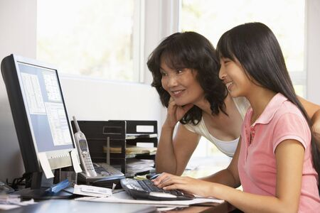 preadolescent: Woman Watching Her Daughter Use A Computer