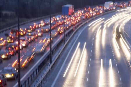 Blurred Tail Lights And Traffic Lights On Motorway photo