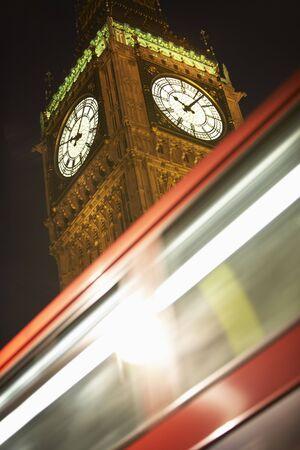 no movement: Double Decker Bus Speeding Past Big Ben, London, England