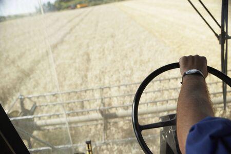 Combine Harvester Working In Field photo