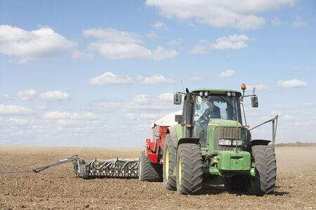 seed drill: Tractor Planting Seed In Field