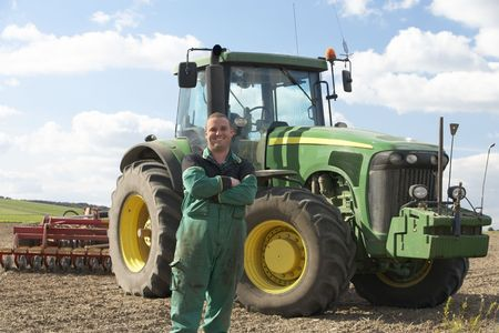 Driver Standing In Front Of Tractor Stock Photo - 5040626
