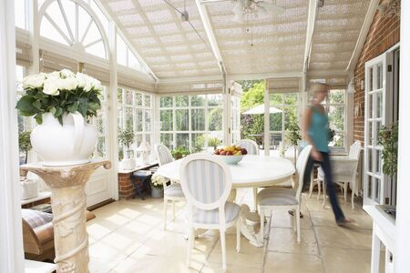 Woman Walking Through Conservatory Stock Photo - 5040672