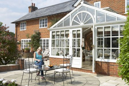 Exterior Of House With Conservatory And Patio Stock Photo - 5041022