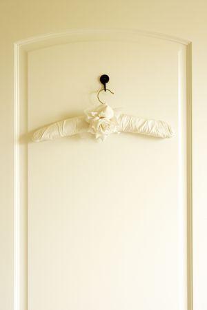Coat Hanger On Back Of Door photo