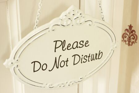 hanging sign: Do Not Disturb Sign Hanging On Door