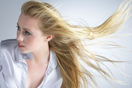 Young Woman With Hair Blowing Behind photo