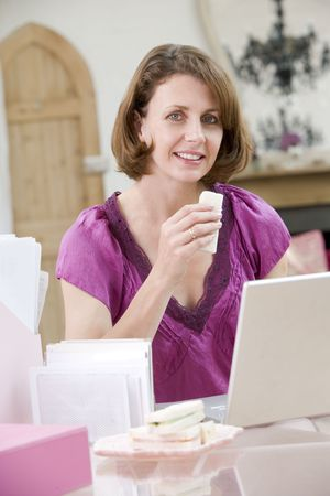 Woman eating lunch at her desk photo