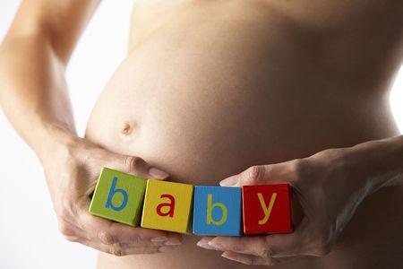 Pregnant Woman Holding Blocks Spelling