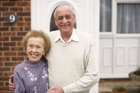 Senior Couple Outside Home Stock Photo - 5041451