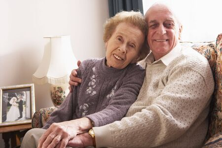 Loving Senior Couple Relaxing At Home Stock Photo - 5041893