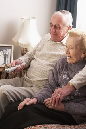 Senior Couple Watching TV At Home photo