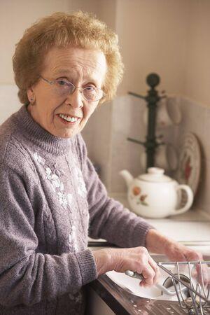 Senior Woman Washing Up At Sink Stock Photo - 5043412