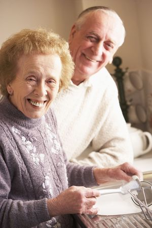 Senior Couple Washing Up At Sink photo