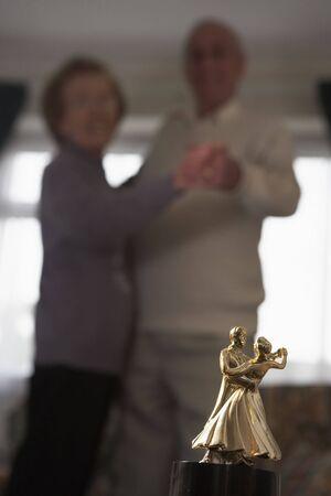 Senior Couple With Dance Trophy photo
