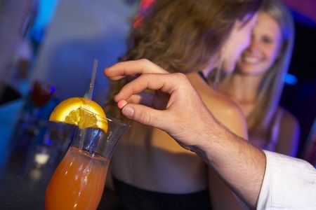 rape: Man Drugging Womans Drink In Bar