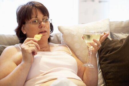 unattractive: Overweight Woman Relaxing On Sofa