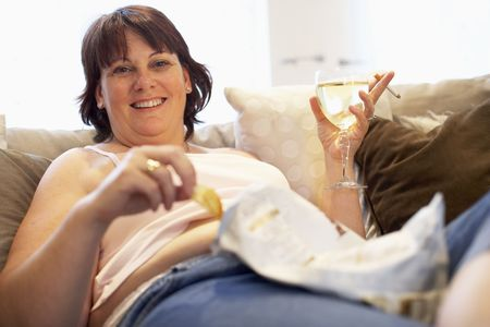 Overweight Woman Relaxing On Sofa photo