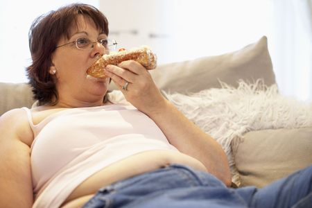 chubby girl: Overweight Woman Relaxing On Sofa