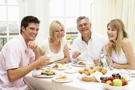 Family Group Enjoying Hotel Breakfast photo