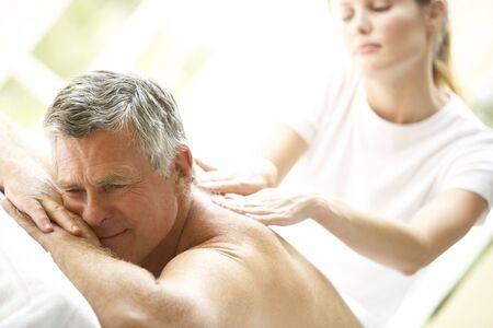 50s man: Middle Aged Man Enjoying Massage