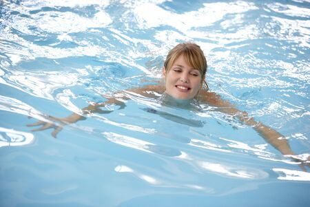 Young Woman Swimming In Pool photo