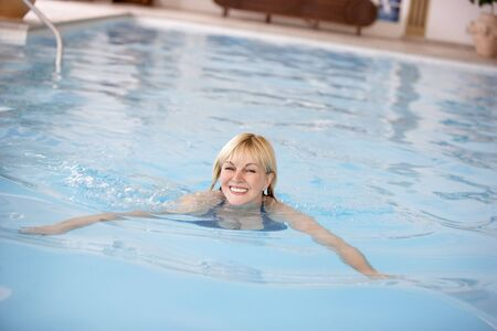 Middle Aged Woman Swimming In Pool photo