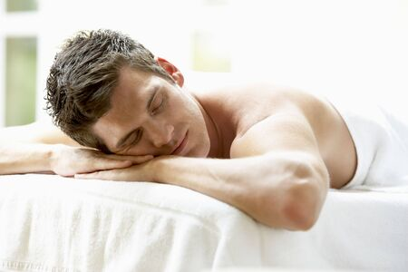 man resting: Young Man Relaxing On Massage Table