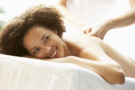 Young Woman Enjoying Hot Stone Treatment Stock Photo - 5041339