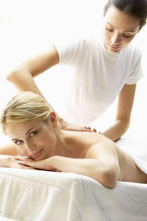 Young Woman Enjoying Massage photo