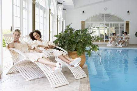 Women Relaxing Around Pool At Spa photo