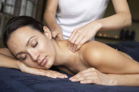 Young Woman Enjoying Massage Stock Photo - 5041509
