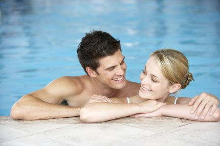 Young Couple Swimming In Pool Stock Photo - 5041565