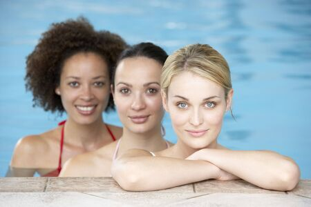 Three Female Friends In Swimming Pool photo