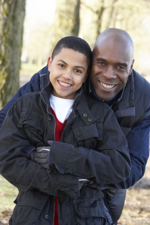 Father And Son On Autumn Walk photo