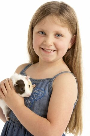 Young Girl Holding Pet Guinea Pig photo