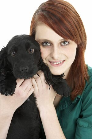 Girl With Black Spaniel Puppy photo