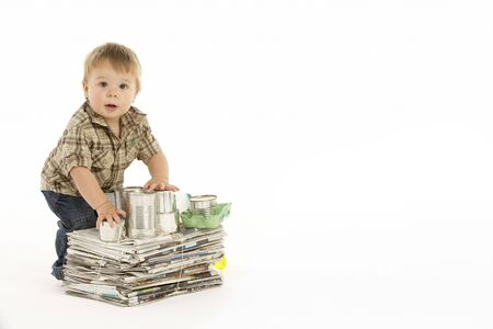 garbage collection: Young Boy Recycling In Studio