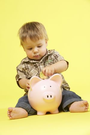 Toddler In Studio With Piggy Bank Stock Photo - 5297053