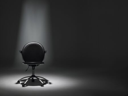 swivel: Empty Office Chair In Spotlight