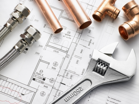 pipe wrench: Plumbing Equipment On House Plans Stock Photo