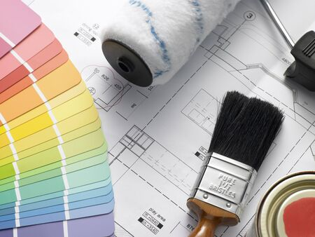 redecorating: Decorating Equipment On House Plans Stock Photo