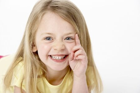 mischievious: Portrait Of Smiling Young Girl
