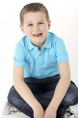 Young Boy Sitting In Studio photo