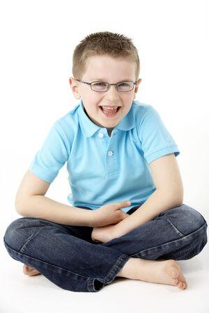 elementary age boy: Young Boy Sitting In Studio