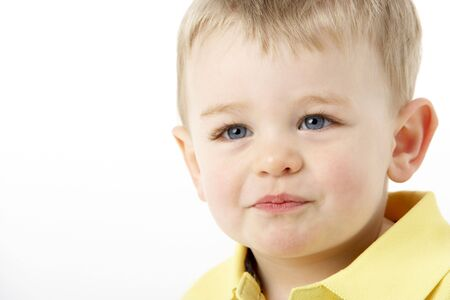 Portrait Of Smiling Young Boy photo